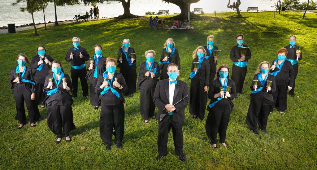 Handbell Ringers standing in formation holding handbells